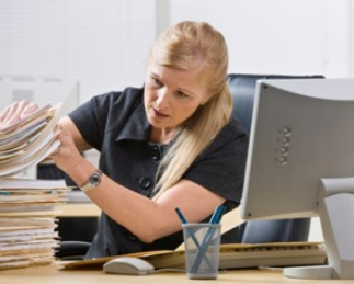 Woman using old filing methods