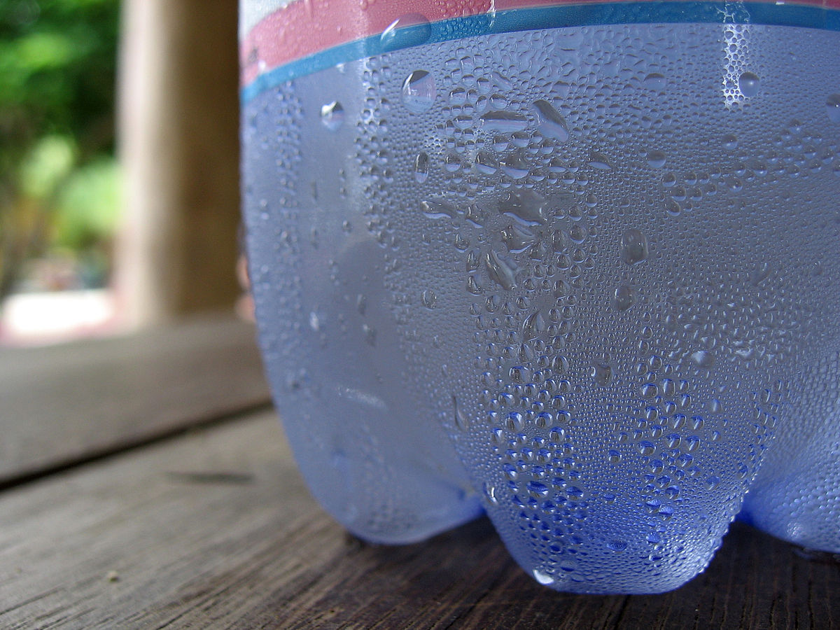 Condensation forming on cold soda bottle, an example