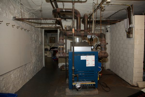 Boiler with Boiler Pipes in basement of bed and breakfast